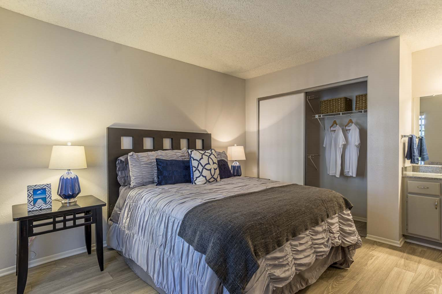 Master bedroom at Hensley at Corona Pointe Apartments in Corona, CA