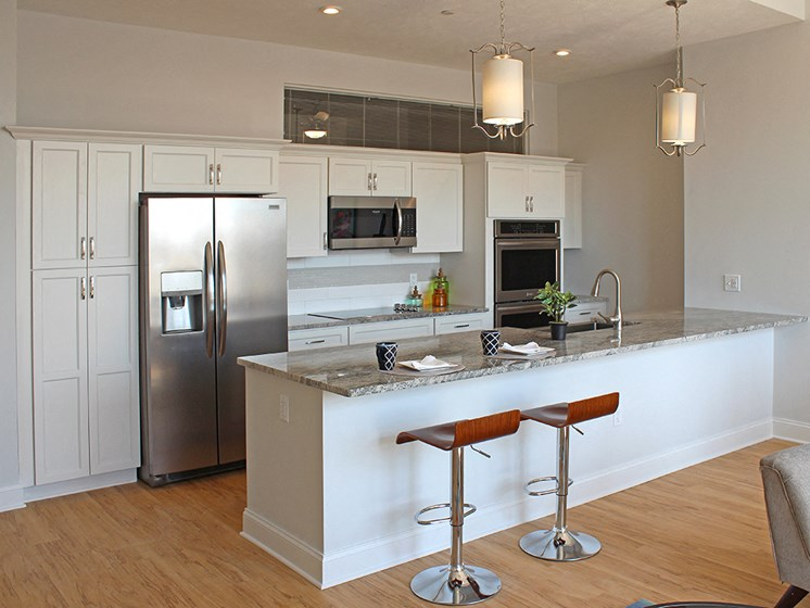 Kitchen Island With Pendent Lights at Residences at Halle, Ohio