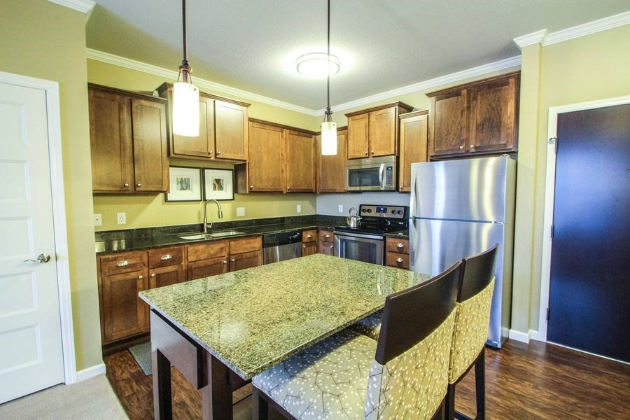 Victoria Park Apartments Kitchen with Designer Cabinetry & Granite Countertops