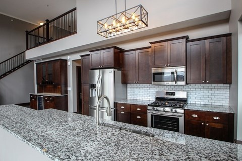 Designer Kitchen Equipped with Stainless Steal Appliances & Designer Cabinetry