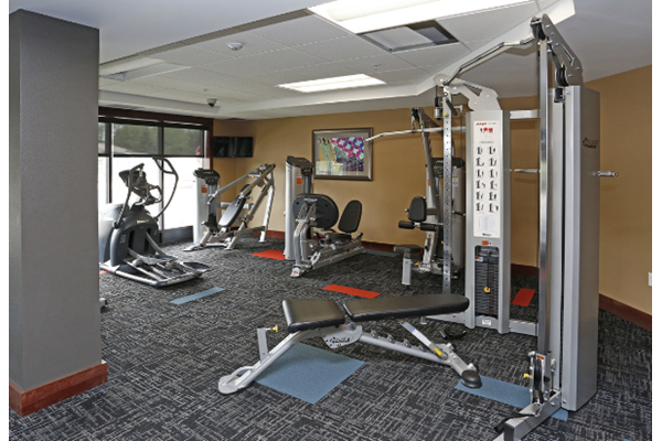 V2 Apartments Fitness Center with Weight Machines