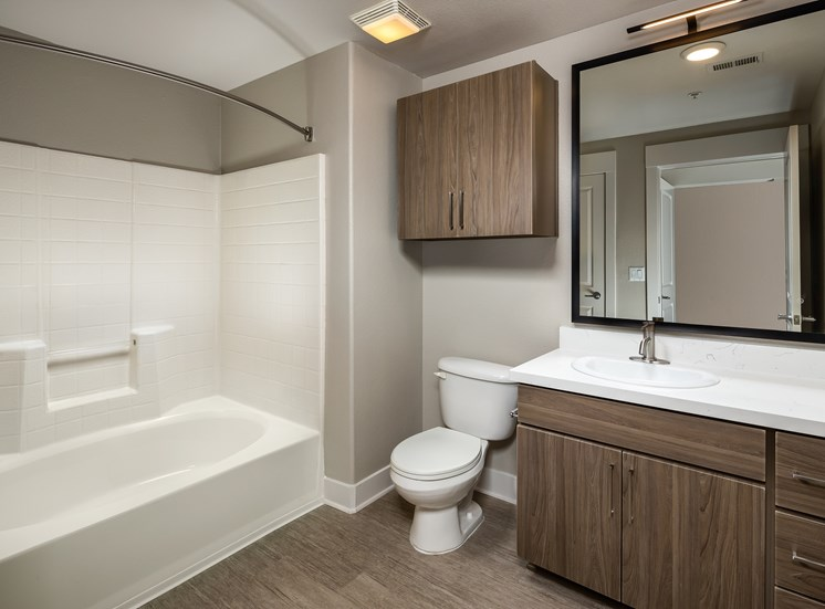 Large Soaking Tub In Master Bathroom with A Tile Surround at The Madison at Town Center, California