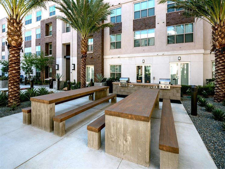 Outdoor Sitting Area with Cozy Fire Pit at Monterey Station, Pomona, CA