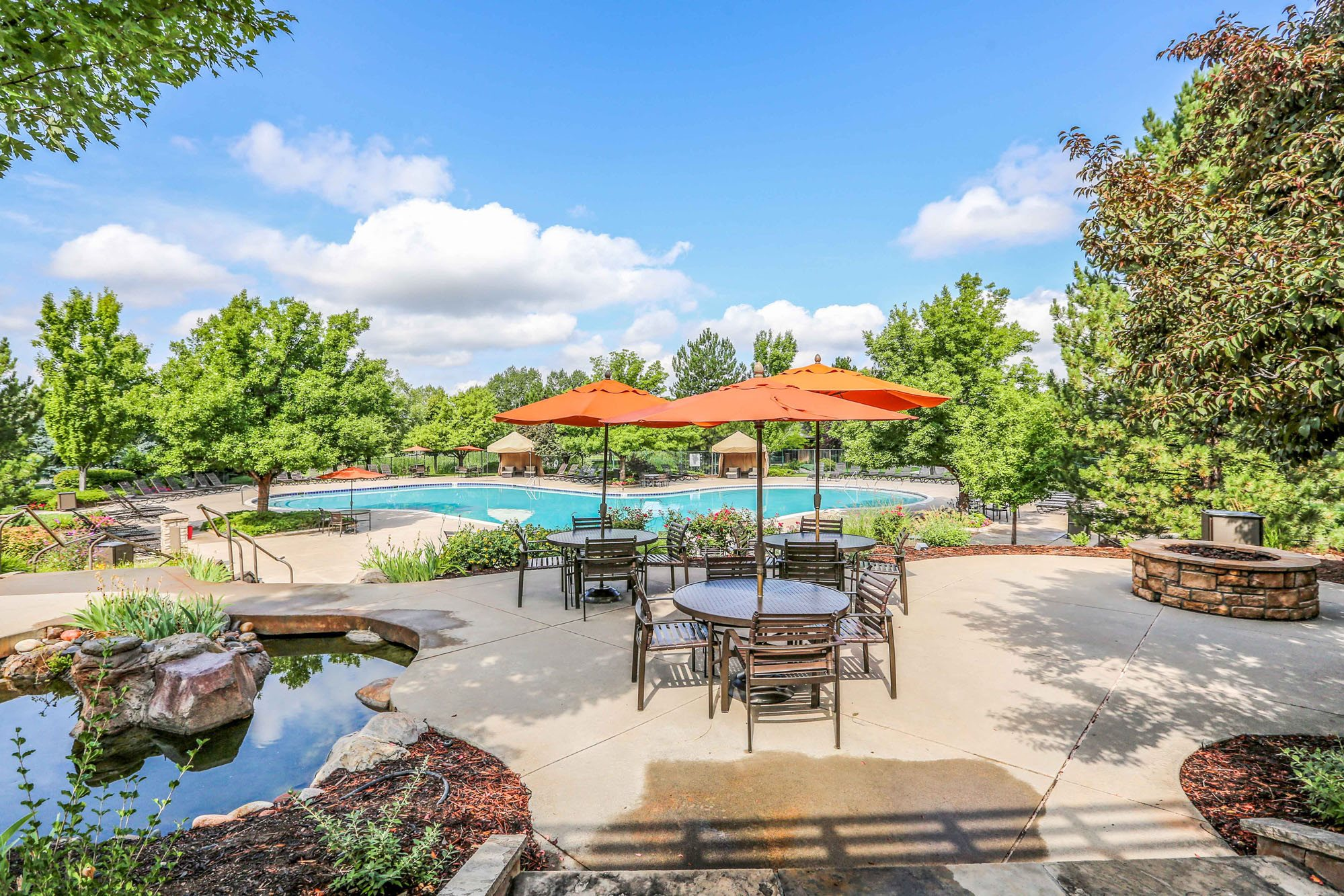 Luxury Apartments in Highlands Ranch, CO - Palomino Park Resort Style Poolside Lounge With Shaded Seating and Firepit