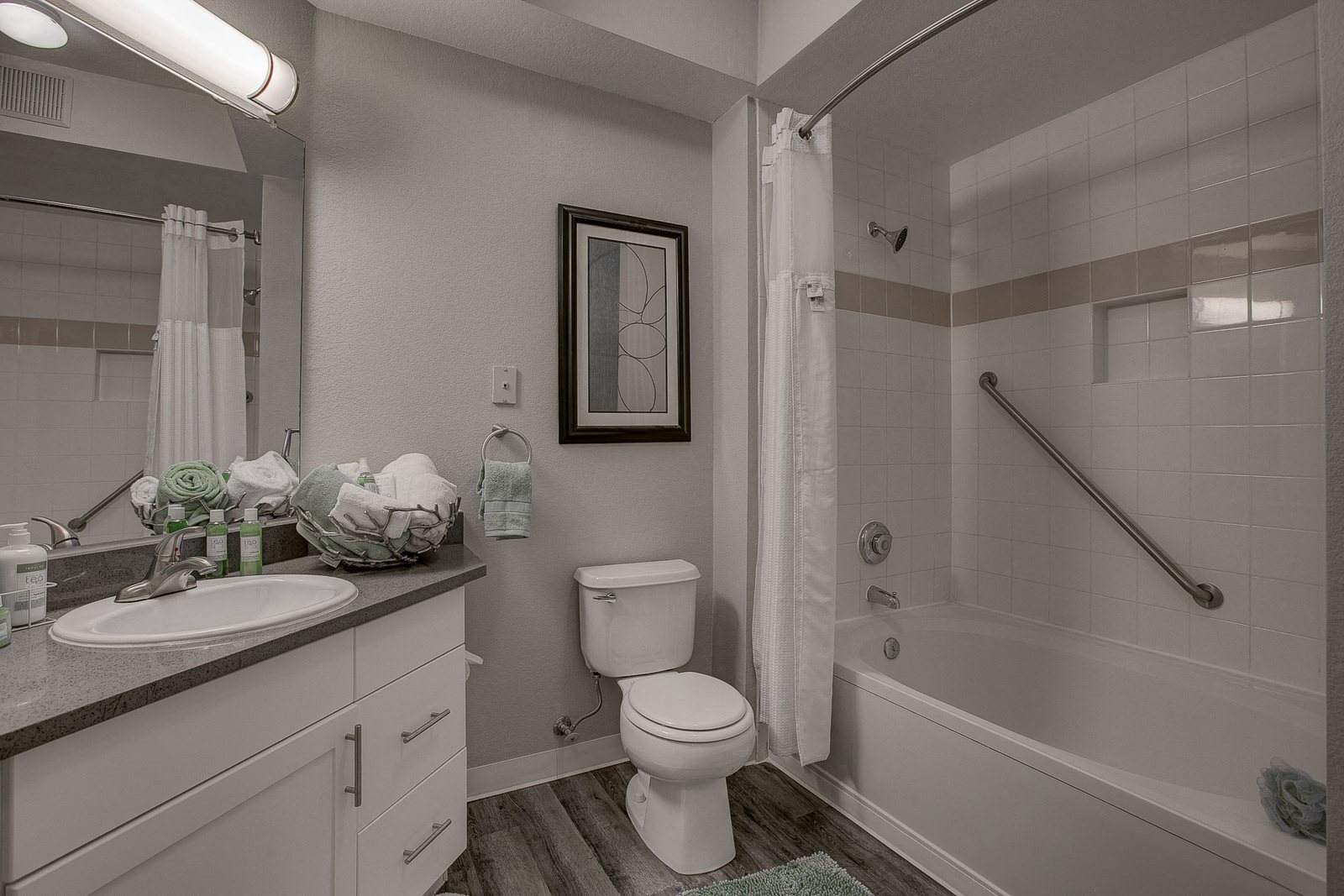 Luxury Highlands Ranch Apartments-Palomino Park Apartments Bathroom With Deep Tub And Large Mirror