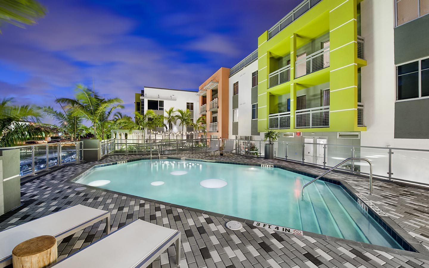Pool Side Relaxing Area At Sofa Downtown Luxury Apartments Florida