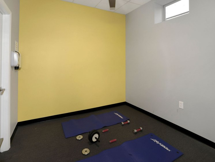 room with yoga mats and equipment