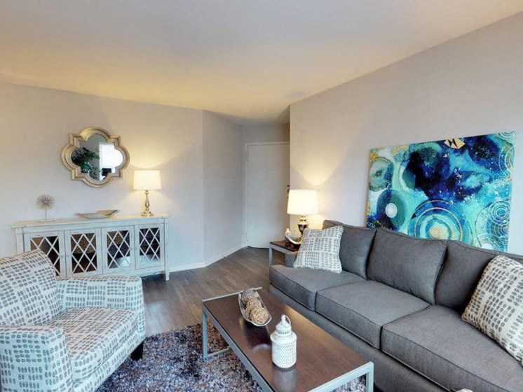fully furnished living room with hardwood floors