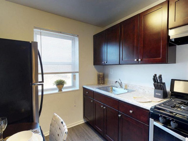 kitchen with gas range and hardwood cabinets