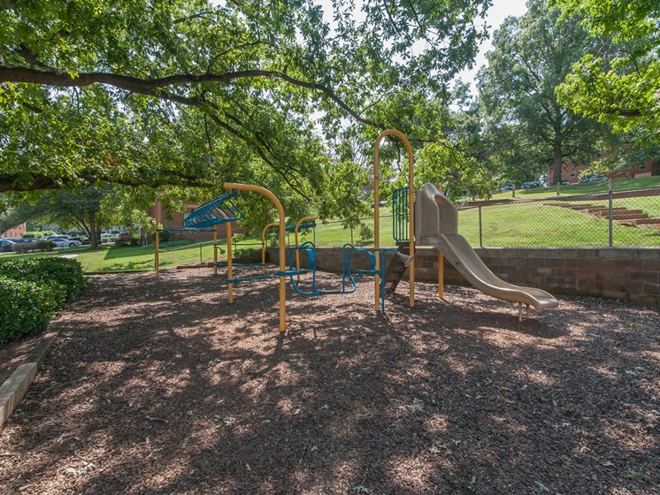 outdoor playground with slides and swings