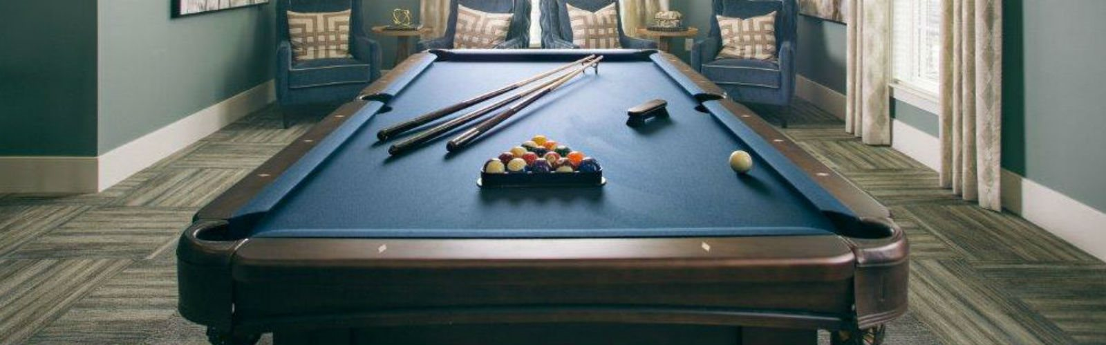Pool table in billiards room