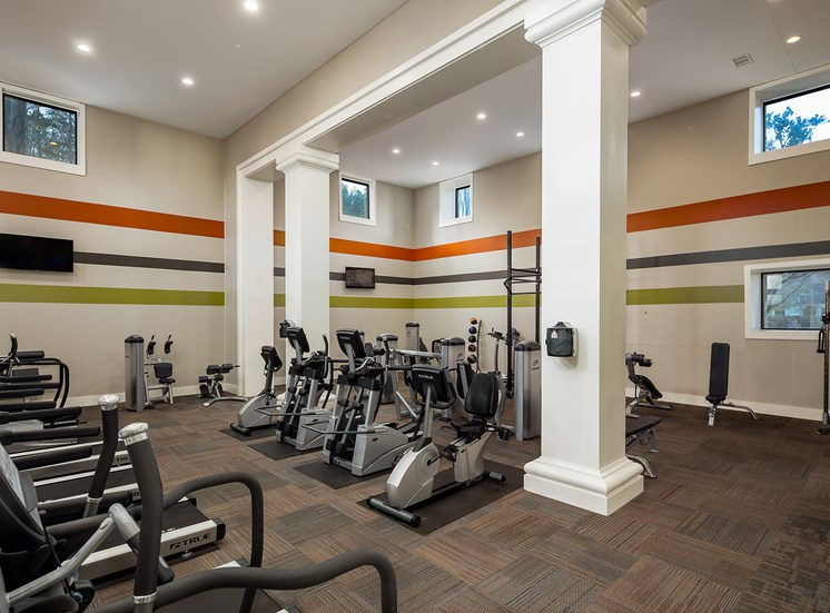 fitness center with treadmills and recumbent bikes