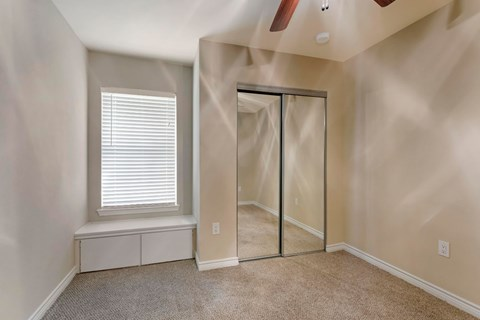 Bedroom with Mirrored Closet