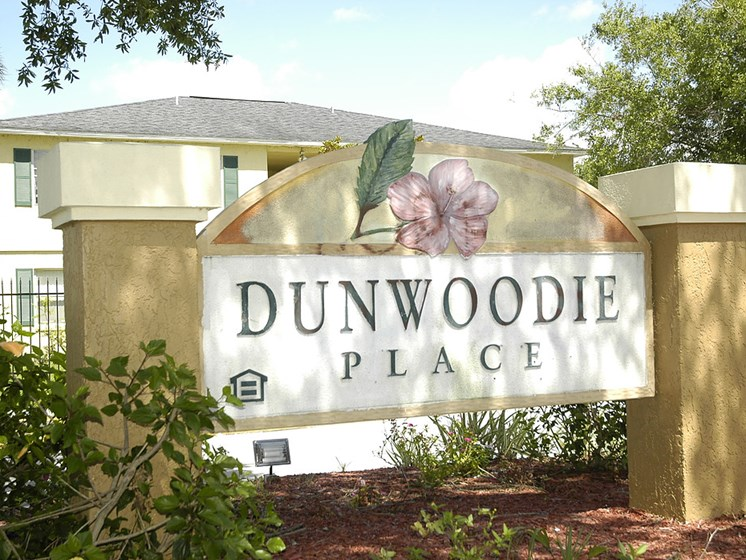 exterior sign with community name on it_Dunwoodie Place Apartments Orlando, FL