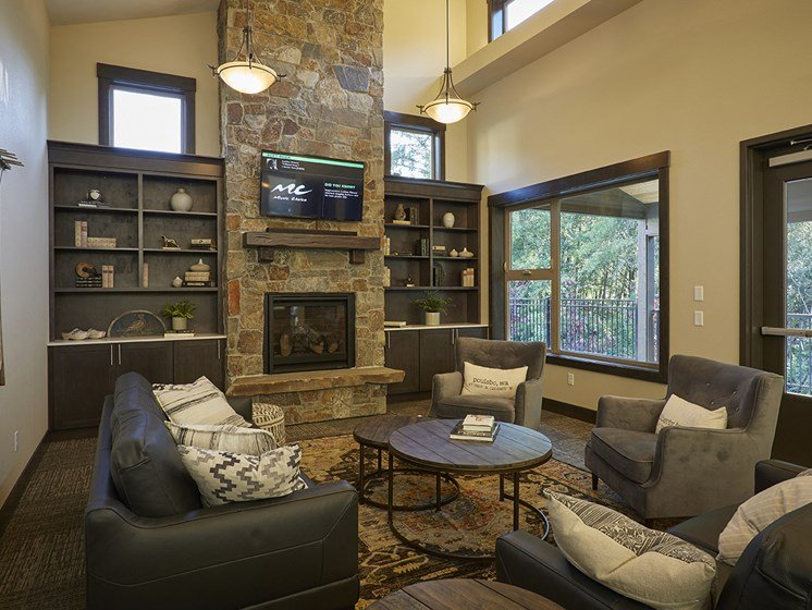 Resident clubhouse with sitting area with couches.