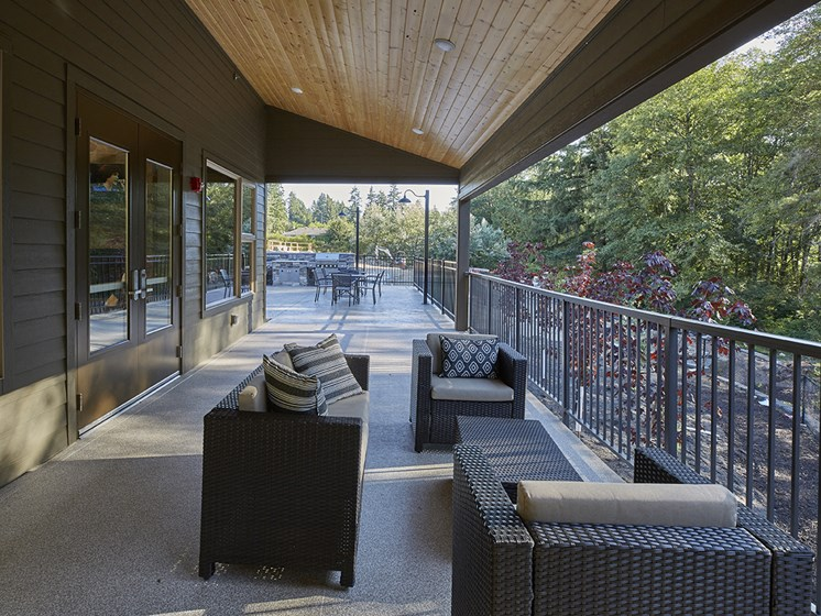 Outdoor lounge area with sitting areas.