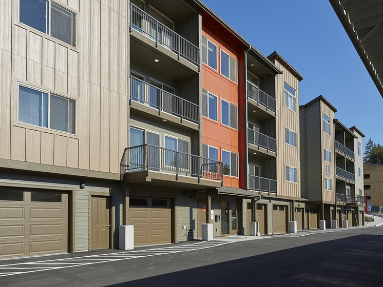 Exterior image of the property buildings with attached garages. Enter your apartment from the garage.
