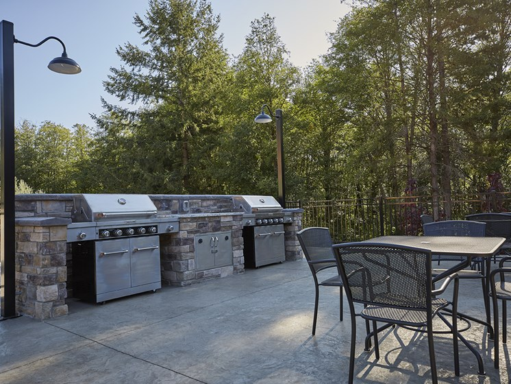 Outdoor gas barbecue stations and picnic area.