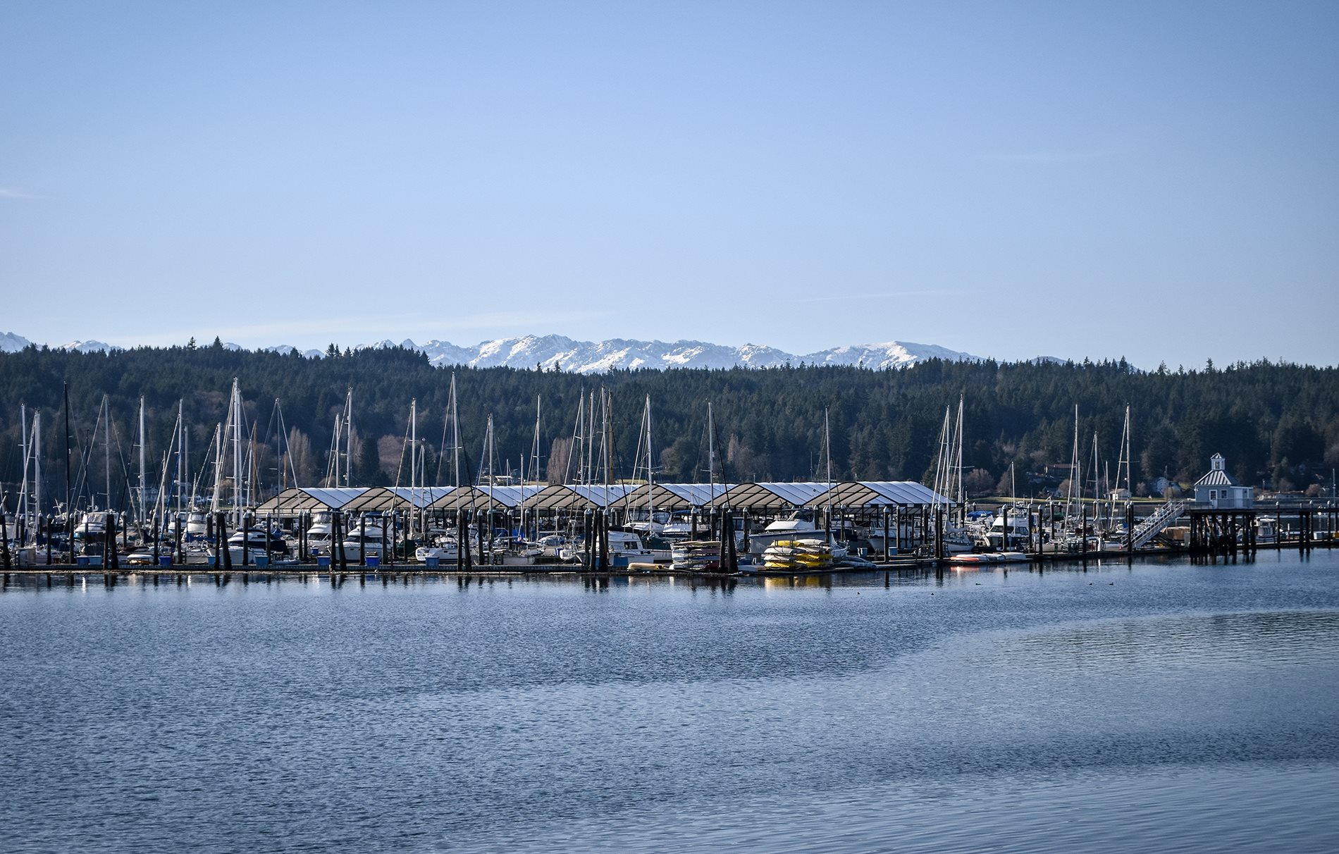 Stock image of bayside with dock and sail boats