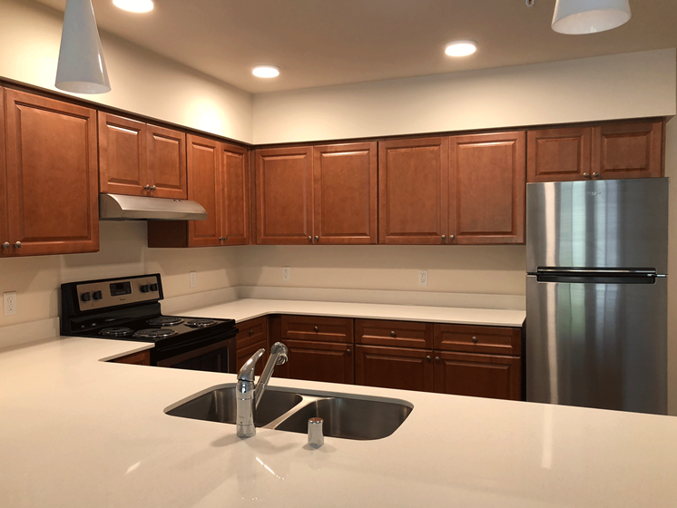 Kitchen is equipped with refrigerator, dishwasher, stove, range and garbage disposal.