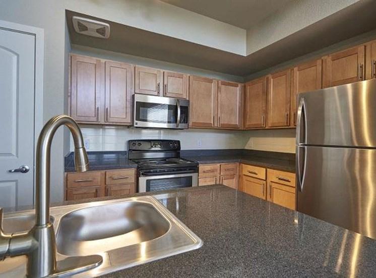 The Ridge At Thornton Apartments kitchen with granite countertops