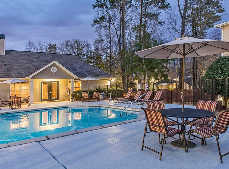 Enjoy Our Pool Deck with Patio and Chairs at Addison on Cobblestone Apartment Homes, Fayetteville, GA 30215