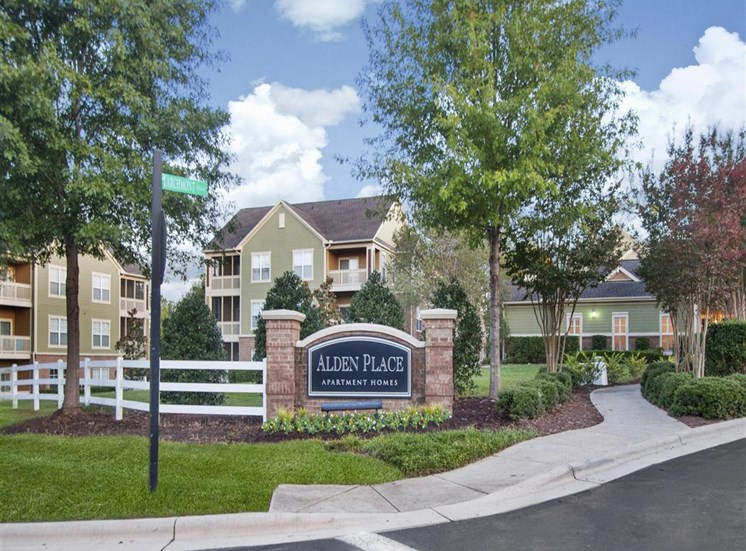 Lush landscaping surrounds you as you drive into Alden Place at South Square Apartments, Durham, NC 27707