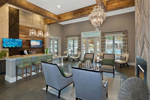 Gorgeous New Clubhouse with Art Deco Design, Bar Height Entertainment and Seating Areas. Complete with Cozy Fireplace at Ansley at Roberts Lake Apartment Homes, Arden, NC, 28704?