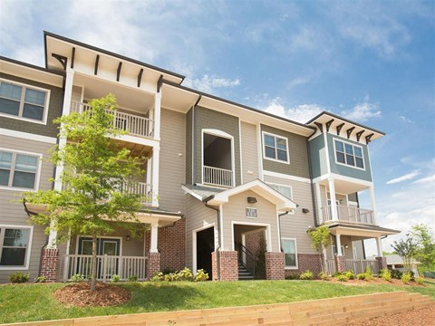 Modern Exteriors Give a Wonderful First Impression of Ansley at Roberts Lake. Private Balconies and Patios with Each Home at Ansley at Roberts Lake Apartment Homes, Arden, NC, 28704