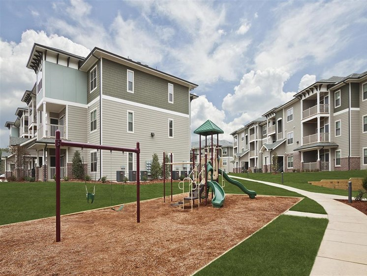 Children have a place to run and play at Ansley at Roberts Lake too! Slides, Climbing Equipment and Bike Parking at Ansley at Roberts Lake Apartment Homes, Arden, NC, 28704