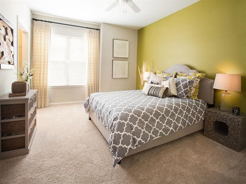 Spacious Bedrooms with Two-Tone Paint Colors, Ceiling Fans and Cozy Carpeting at Ansley at Roberts Lake Apartment Homes, Arden, NC, 28704