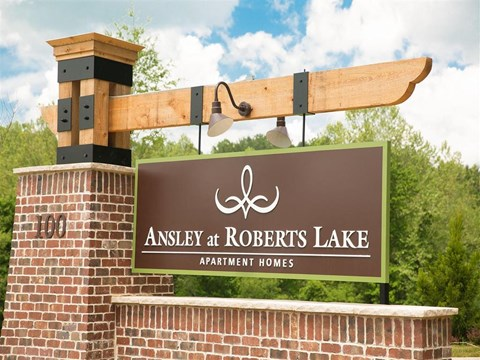 Lush landscaping surrounds you as you drive into Ansley at Roberts Lake Apartment Homes, Arden, NC, 28704
