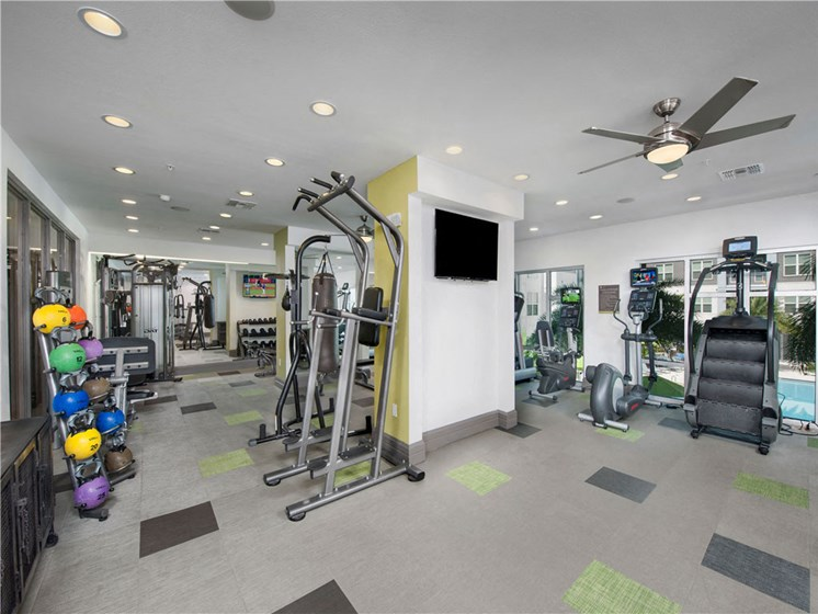 Health and Fitness Club including TVs, Boxing Studio, Yoga Studio, Indoor Spin Studio and Cardio and Weight Training at Bleecker Hyde Park, Tampa, FL, 33606