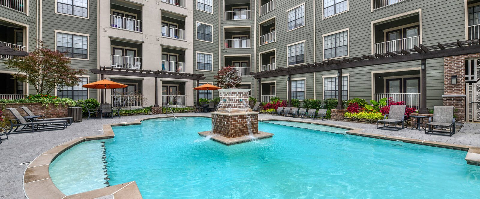 Our refreshing pool with a tranquil fountain is a wonderful sight and sound! Open from 10 am - 10 pm at The Bristol on Union Apartment Homes, Memphis, TN 38104