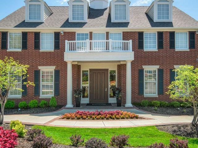 Lush landscaping surrounds you as you drive into Cambridge Square Apartments, Overland Park, KS 66211