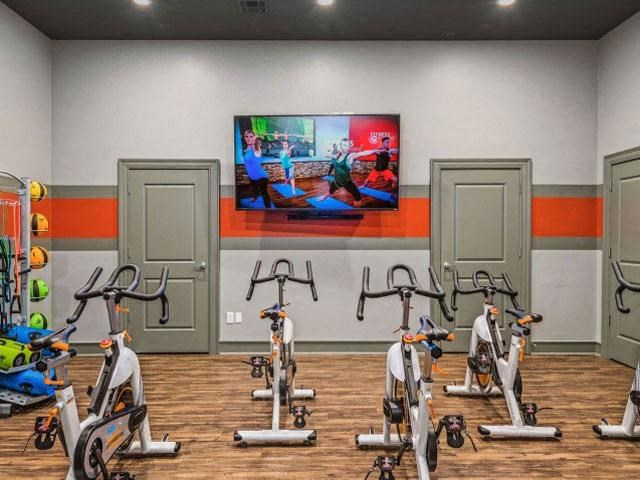 State of the Art Fitness Center Open 24 Hours with Multiple Cardio Machines, Weight Training and Flat Screen TV to Enjoy during your Work Out at Cambridge Square Apartments, Overland Park, KS 66211