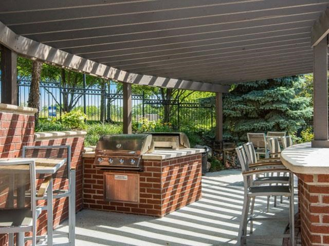 Outdoor Social Area with Grills and Gazebo Covering Perfect for Social Gatherings at Cambridge Square Apartments, Overland Park, KS 66211