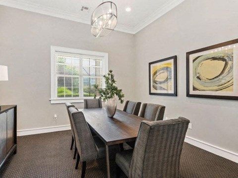 Gorgeous Dining Room Space with Elegant Lighting and Wood Plank Vinyl Flooring at Cambridge Square Apartments, Overland Park, KS 66211
