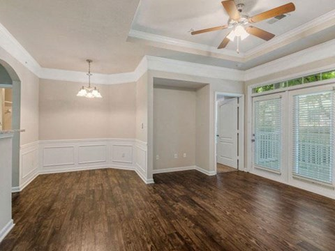 Gorgeous Modern Living Room with Elegant Crown Moulding and Wood Plank Vinyl Flooring (in Select Units) at Cambridge Square Apartments, Overland Park, KS 66211