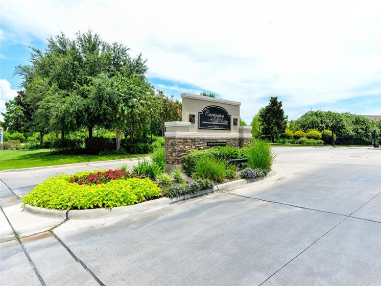 Lush landscaping surrounds you as you drive into Carrington Park At Gulf Pointe, Houston, TX 77089