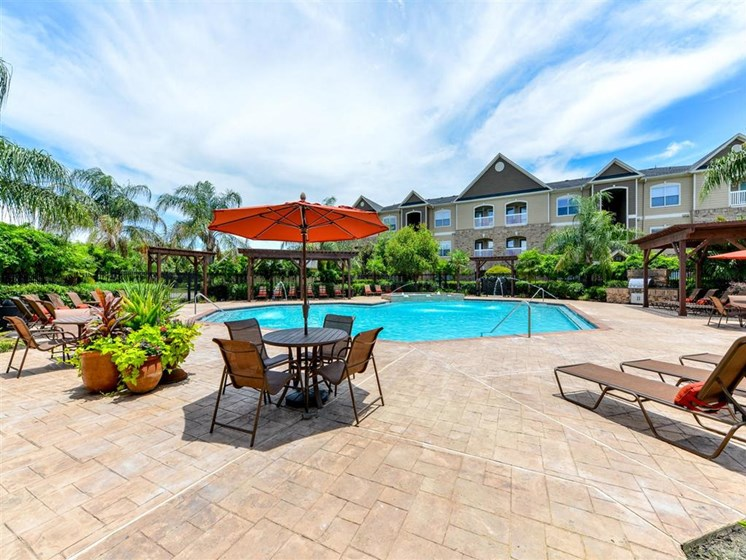 Refreshing Swimming Pool and Relaxing Sundeck with WiFi Access at Carrington Park At Gulf Pointe, Houston, TX 77089