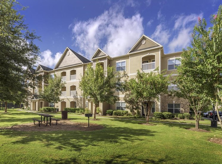 Meticulously maintained grounds with mature trees surround the apartment homes at Carrington Park At Gulf Pointe, Houston, TX 77089