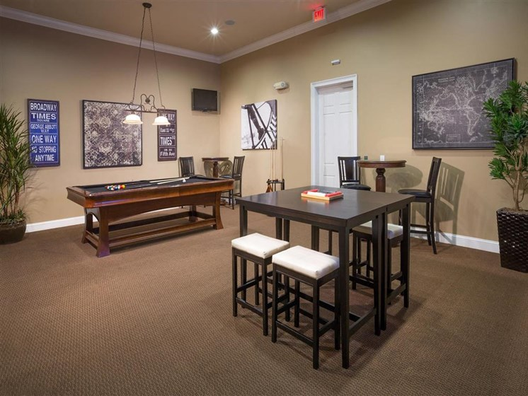 Entertainment Room with Televisions and Billiards at Courtney Bend Apartment Homes, Hardeeville, SC 29927