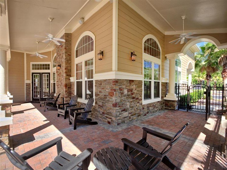Enjoy Our Pool Deck with Patio and Chairs at Courtney Bend Apartment Homes, Hardeeville, SC 29927
