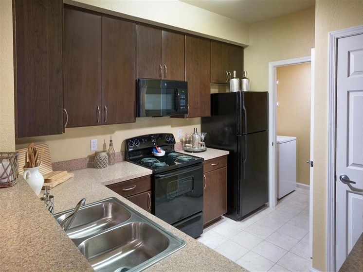 New Kitchens with Ceramic Tile Flooring, Custom Upgraded Cabinetry and Sleek Black Appliances at Courtney Bend Apartment Homes, Hardeeville, SC 29927