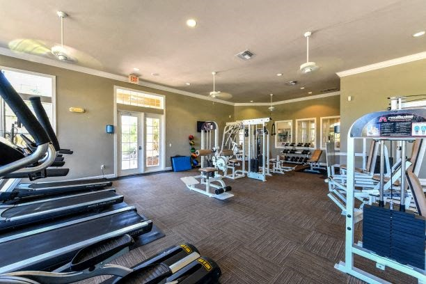 State-of-the-Art Athletic Club featuring Free Weights, Circuit Training Stations & Cardio Stations w/ Built-in TVs at Courtney Isles Apartment Homes, Yulee, FL 32097