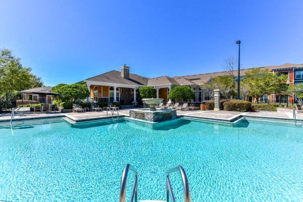 Resort Style Swimming Pool with Poolside Grilling Area and Spacious Sun Deck at Courtney Isles Apartment Homes, Yulee, FL 32097