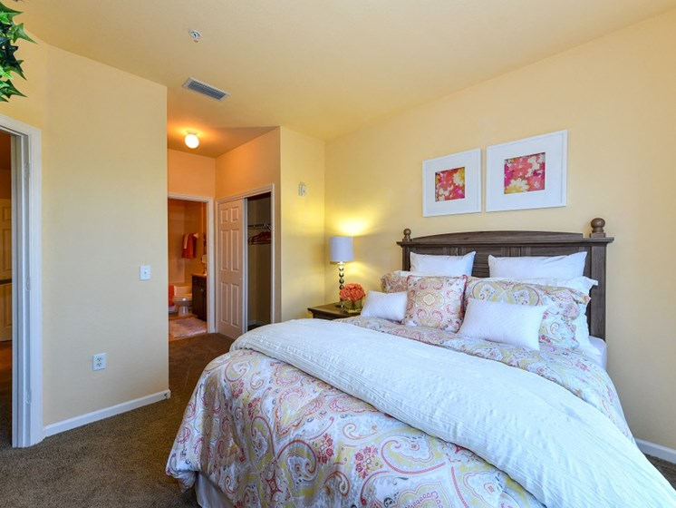 Master Bedroom Feels Large and Spacious with Impressive 9 Foot Ceilings and Large Walk-In Closets at Courtney Isles Apartment Homes, Yulee, FL 32097