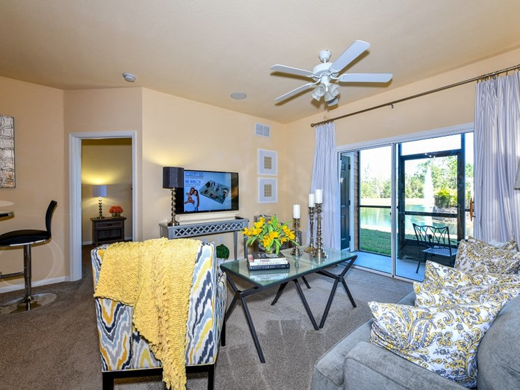 Large Open Floorplans with Ceiling Fans in Living Areas at Courtney Isles Apartment Homes, Yulee, FL 32097