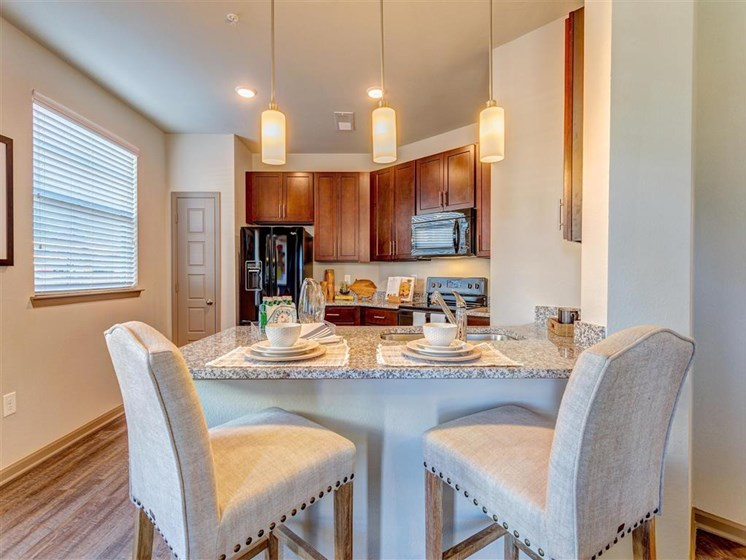 Gorgeous Dining Room Space with Elegant Crown Moulding and Chair Railing and Wood Plank Vinyl Flooring (in Select Units) at Creekside at Providence Apartments, Mt. Juliet, TN 37122